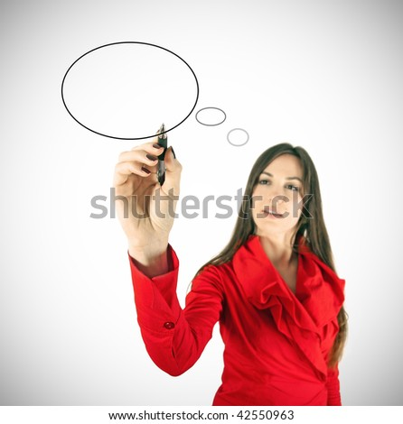 Beauty girl in red writing her thinking. Focus is on hand with pen. - stock photo