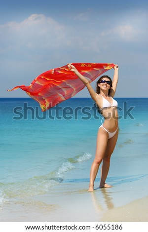 Beauty Girl in white swim suite and red pareo