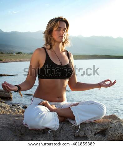 beauty girl in yoga pose on beach - stock photo