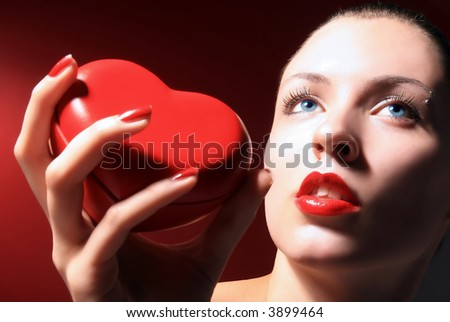 beauty girl is holding and giving red heart