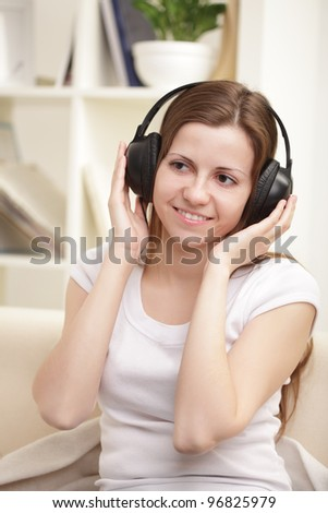 beauty girl listen music in headphones - stock photo