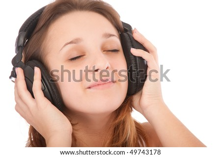Beauty girl listen music in headphones, isolated on white background. - stock photo