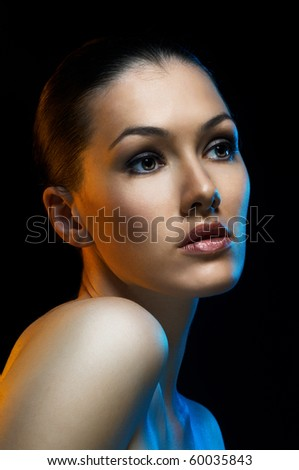 beauty girl on the dark background - stock photo