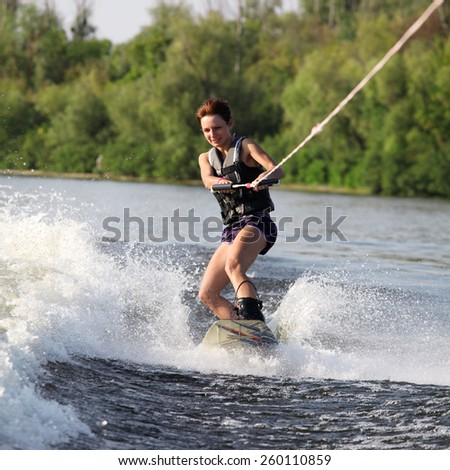 beauty girl on wakeboard - stock photo