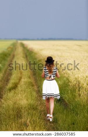 Beauty Girl Outdoors enjoying nature - stock photo