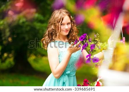 Beauty Girl Outdoors enjoying nature. Beautiful Teenage Model girl with long hair  , Sun Light. Glow Sun. Free Happy Woman. Toned in warm colors - stock photo