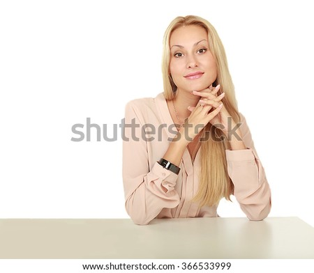 Beauty girl portrait. A young woman with natural clean face sitting at a table, leaning on his elbows on a white background isolated - stock photo