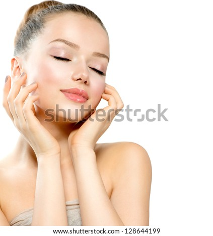Beauty Girl Portrait. Beautiful Young Woman isolated on White Background. Touching Her Face. Fresh Clean Skin. - stock photo