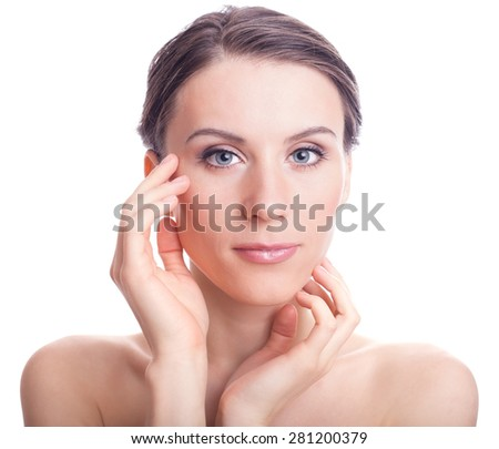 Beauty Girl Portrait. Beautiful Young Woman Touching Her Face isolated on White Background.