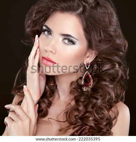 Beauty girl portrait brunette girl model with care skin, professional makeup, wavy hair styling isolated on black background  - stock photo