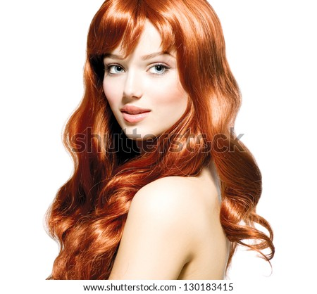 Beauty Girl Portrait. Healthy Long Curly Red Hair. Beautiful Young Woman isolated on a white background - stock photo