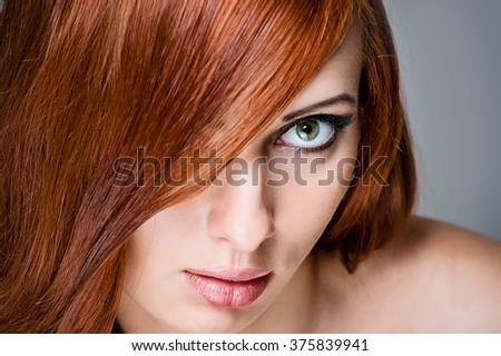 Beauty Girl Portrait. Healthy Long Red Hair. Beautiful Young