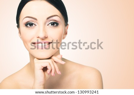 Beauty Girl. Portrait of Beautiful Young Woman looking at Camera - stock photo