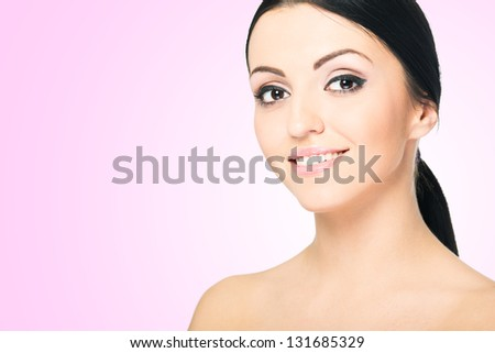 Beauty Girl. Portrait of Beautiful Young Woman looking at Camera. - stock photo
