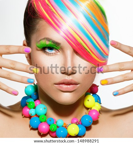 Beauty Girl Portrait with Colorful Makeup, Hair, Nail polish and Accessories. Colourful Studio Shot of Stylish Woman. Vivid Colors. Manicure and Hairstyle. Rainbow Colors  - stock photo
