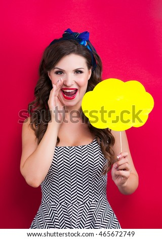 Beauty Girl Portrait with Colorful Makeup, Hair, Nail polish and Accessories. Colourful Studio Shot of Funny Woman. Vivid Colors. Manicure and Hairstyle. Rainbow Colors .