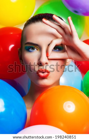 Beauty Girl Portrait with Colorful Makeup, Nail polish and Accessories. Colourful Studio Shot of Funny Woman. Vivid Colors. - stock photo
