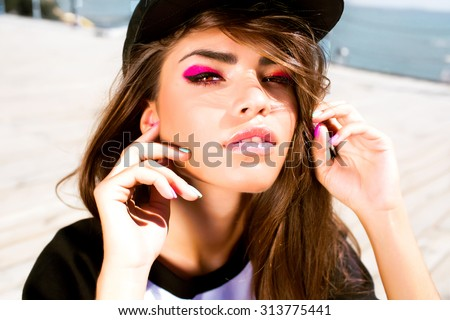 Beauty Girl Portrait with Vivid Makeup and colorful Nail polish.Colourful nails.Fashion Woman portrait close up.Bright Colors.Manicure Make up.Smoky eyes, long eyelashes.Rainbow Colors.hipster girl - stock photo