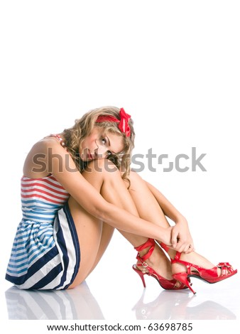 Beauty girl sits on a floor and looking at the camera reflection - stock photo