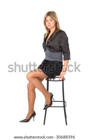 Beauty girl sits on bar stool - stock photo