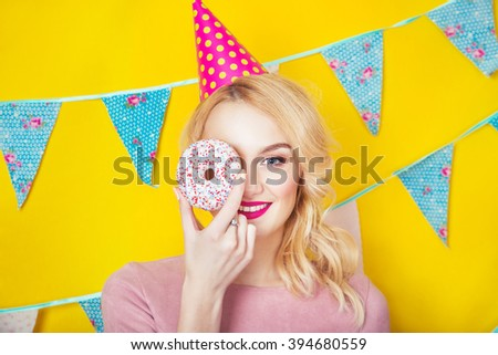 Beauty girl taking colorful donuts. Funny joyful woman with sweets, dessert. Diet, dieting concept. Junk food, Celebration and party.  - stock photo