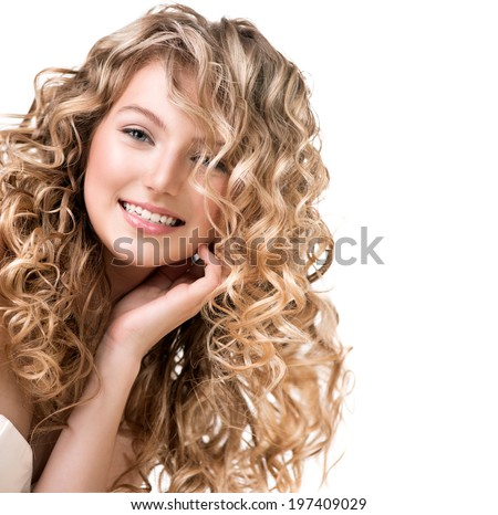 Beauty girl with blonde curly hair. Healthy and long Blond Wavy hair. Beautiful smiling young woman portrait. Beautiful face, natural make up - stock photo