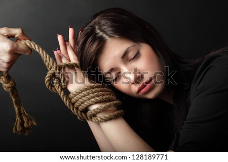 beauty girl with bound hands - stock photo