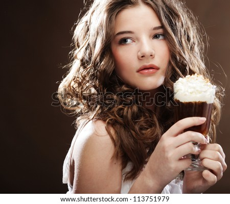 beauty girl with glass of coffee witn cream - stock photo