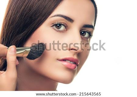Beauty Girl with Makeup Brush. Perfect Skin. Applying Makeup - stock photo