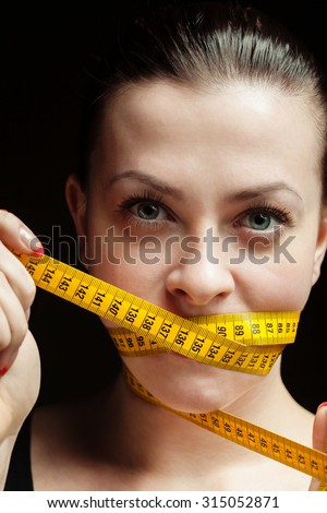 beauty girl with measure tape - stock photo