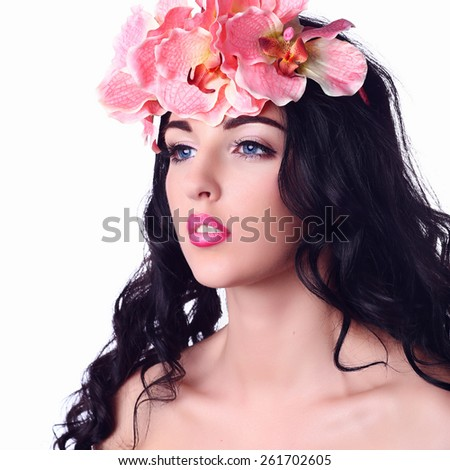 Beauty Girl With Orchid Flowers.Beautiful Model Woman Face. Perfect Skin. Professional Make-up.Makeup. Fashion Art