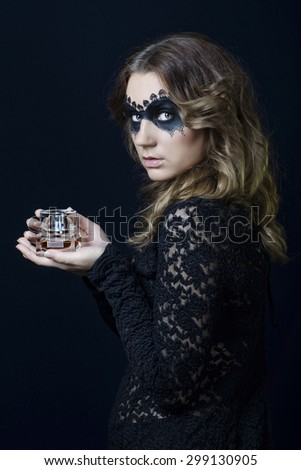 Beauty Girl with perfume.Fashion Art Woman Portrait with fashion mask makeup - stock photo