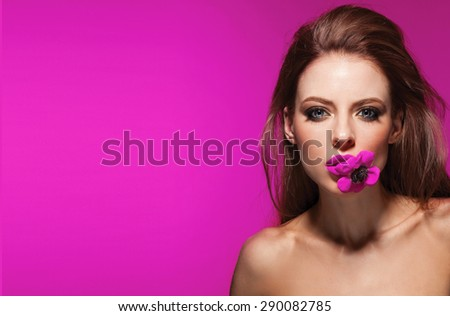 Beauty Girl With pink Flowers.Beautiful Model Woman Face. Perfect Skin. Professional Make-up.Makeup. Fashion Art - stock photo