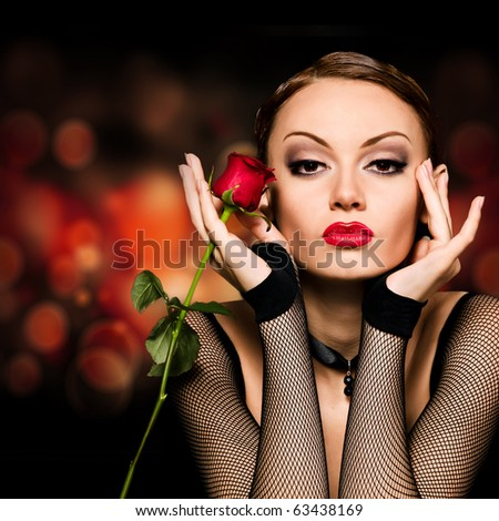Beauty girl with rose against an abstract dark background - stock photo