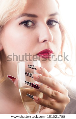 Beauty girl with sensual red lips long nails and glass of champagne isolated on white background