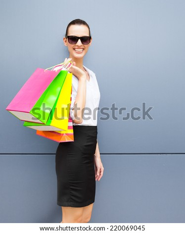 Beauty girl with shopping bags. Shopper. Sales. - stock photo