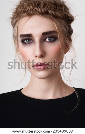 Beauty girl with smoky eyes and pigtails