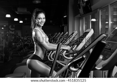 beauty girl workout exercise on elliptic bike