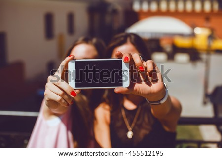 beauty girls make selfie in the street, hipster style, fashion model, outdoor portrait