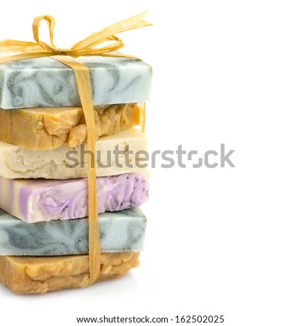 Beauty handmade colorful pile of soap with ribbon - stock photo
