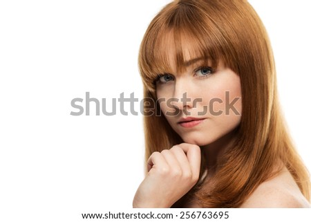 beauty head shot of woman shot in the studio with shiny glossy hair - stock photo