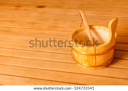 Beauty health spa and lifestyle concept. Interior of finnish sauna and accessories detail bucket with ladle. - stock photo