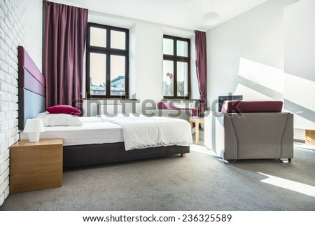 Beauty hotel room interior with violet design - stock photo