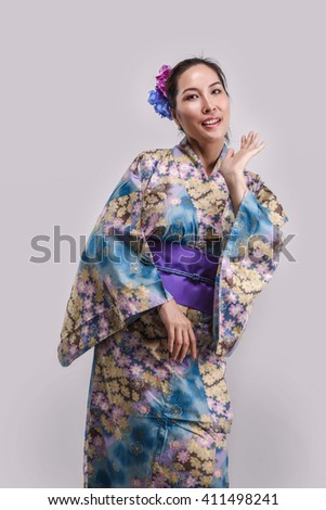 Beauty Japanese Woman in kimono isolate on White Background - stock photo