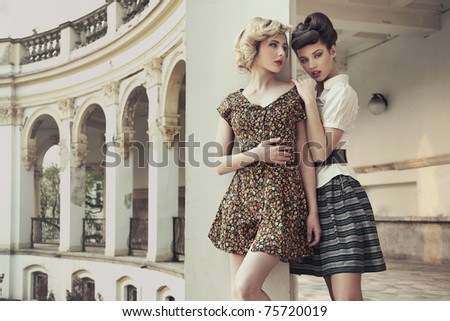Beauty ladies in old castle - stock photo