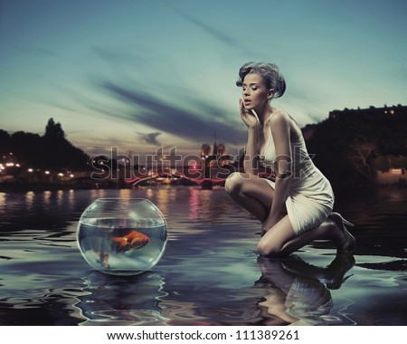 Beauty lady with gold fish - stock photo
