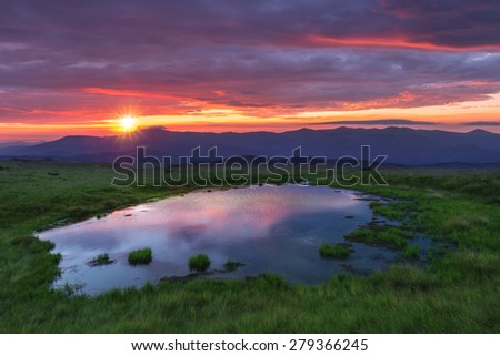 beauty lake in high mountains - stock photo
