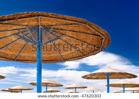 Beauty landscape of sun umbrella, make of reed - stock photo