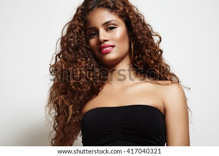 beauty latin woman with a curly hair