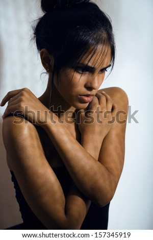 beauty latin young woman in depression, hopelessness look